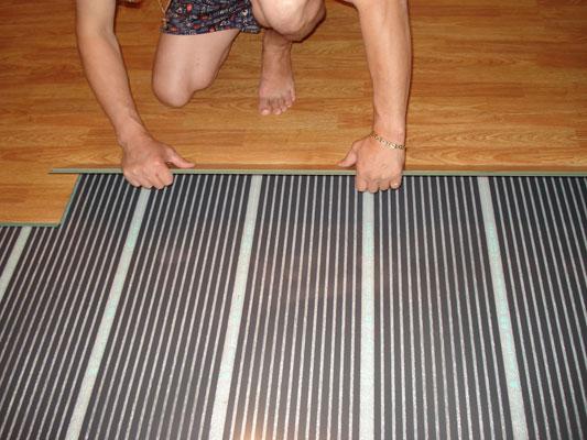 Монтаж плёночного тёплого пола под ламинат